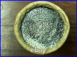 1964 UNC. Kennedy Half Dollar Shotgun Roll (90%) Silver